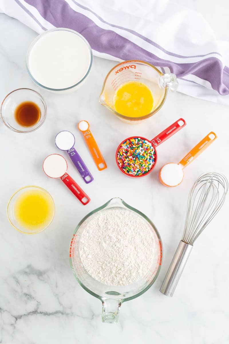 Overhead view of birthday cake pancake ingredients.