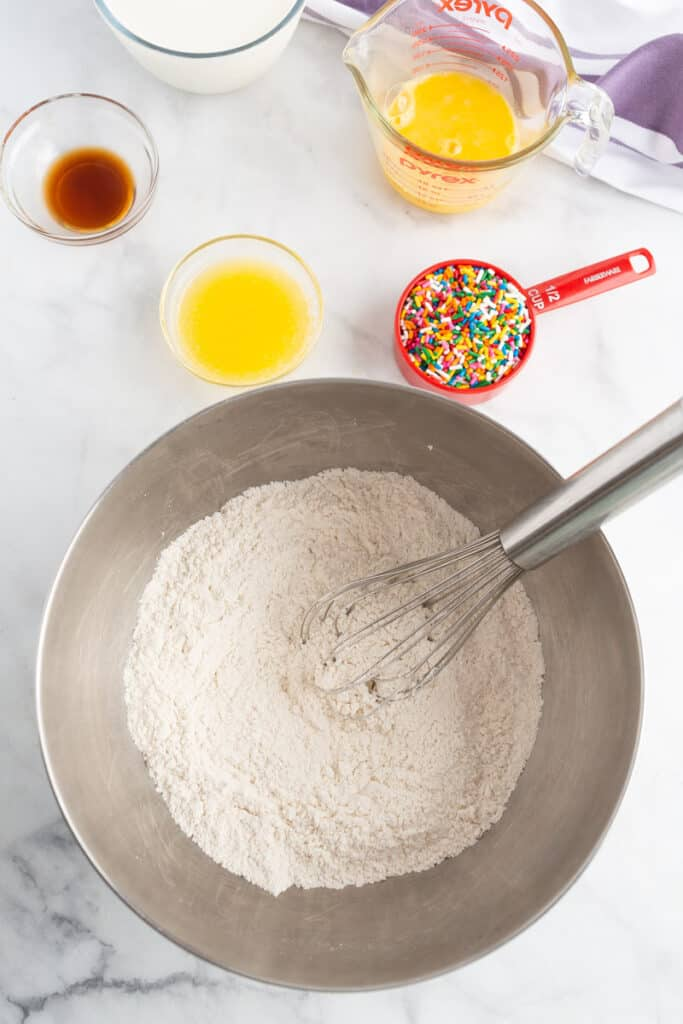 Dry pancake ingredients in a bowl, overhead view.