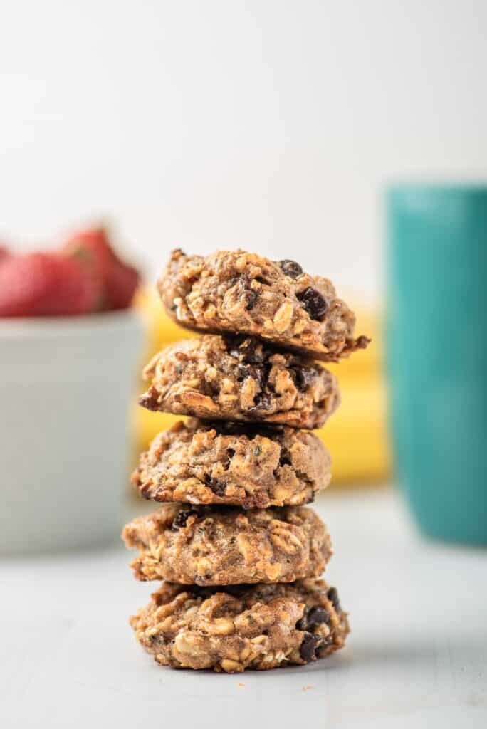 Stack of cookies with oats and chocolate chips in them.