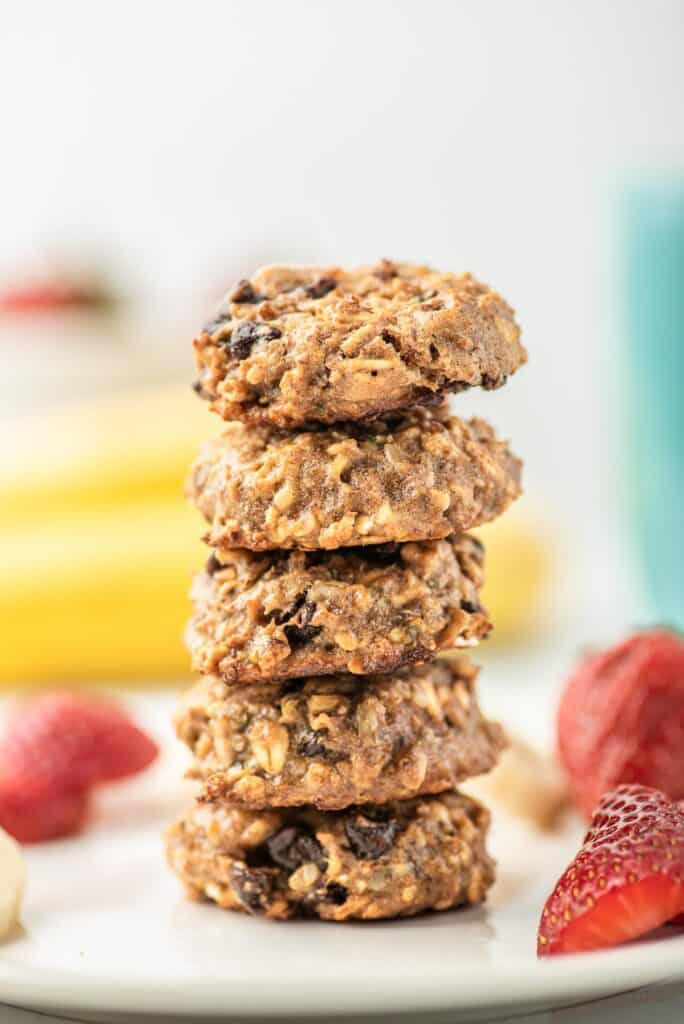 Stack of hearty cookies with oats, chocolate chips, sunflower seeds.