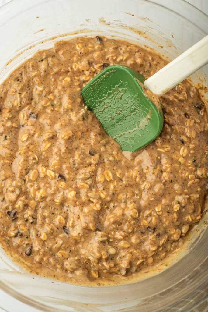 Peanut butter breakfast cookie batter in a glass bowl.