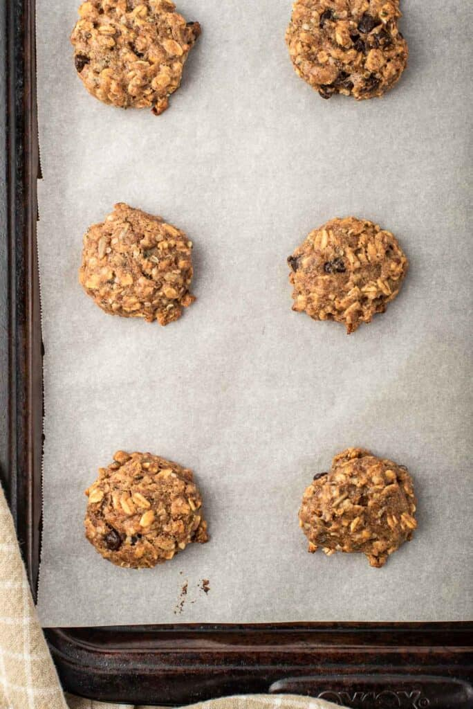 Baked cookies on parchment paper lined baking sheet.