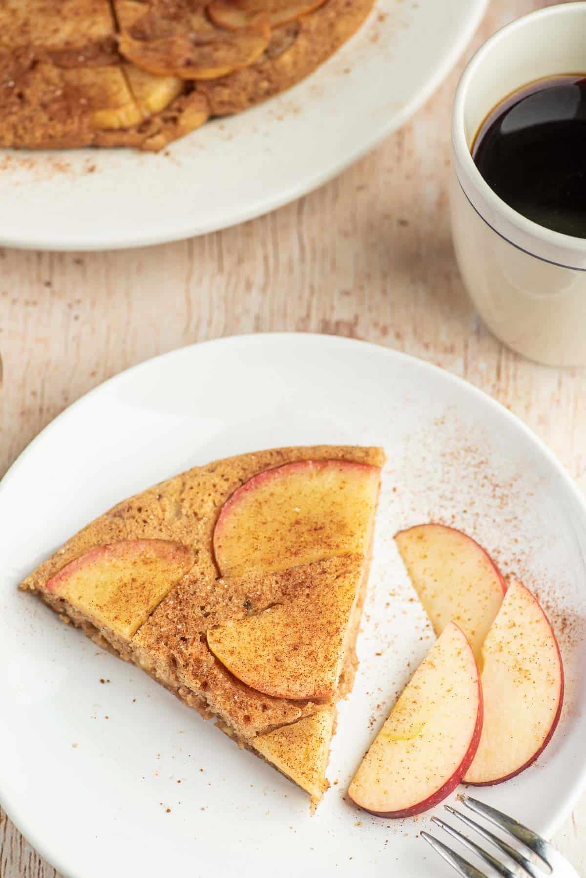 Slice of apple pancake on a plate.