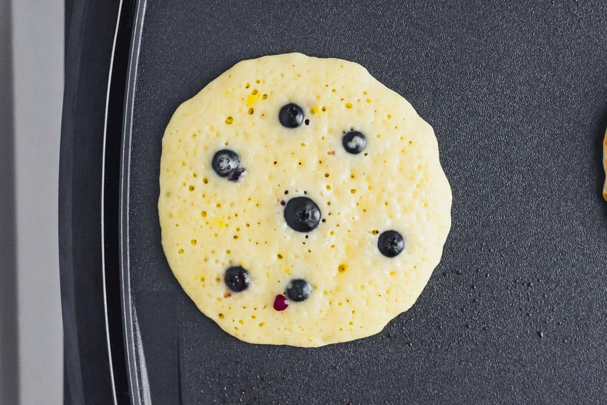 Lemon blueberry pancake on a griddle