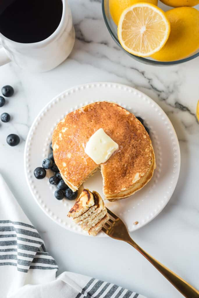 Pancakes with a piece cut out and on a fork.