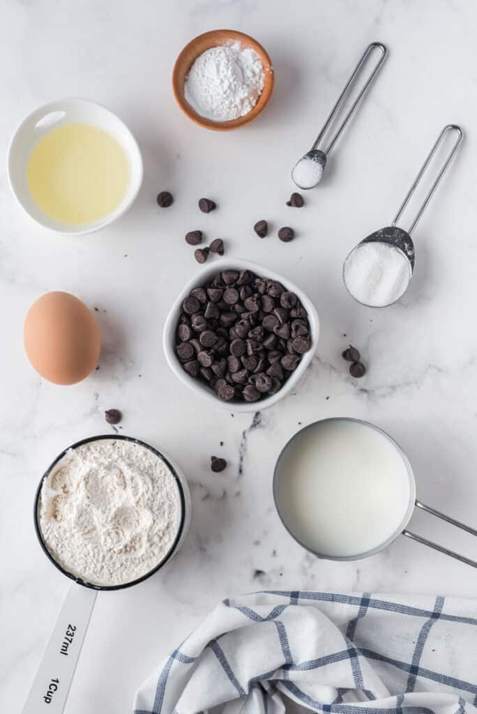 Overhead view of ingredients used to make pancakes with chocolate chips.