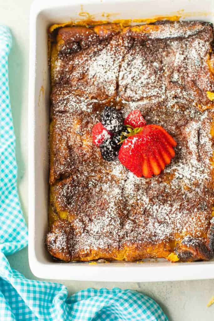 Overhead view of a pan of baked french toast.