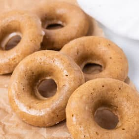 Pile of gingerbread donuts on a brown paper.
