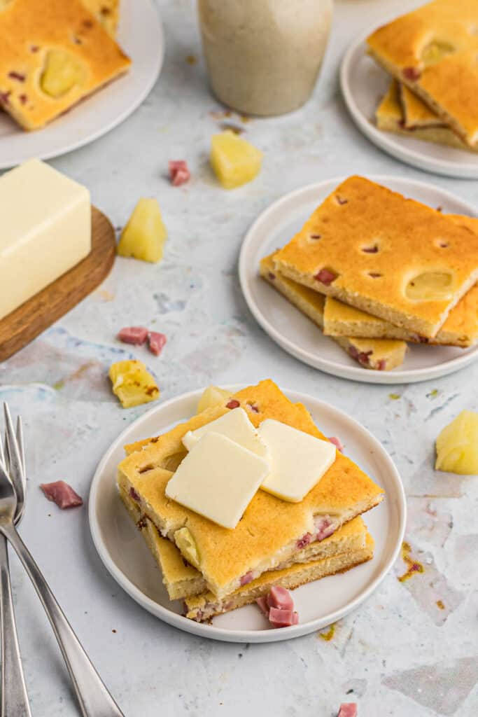 Hawaiian style sheet pan pancakes topped with generous slices of butter.