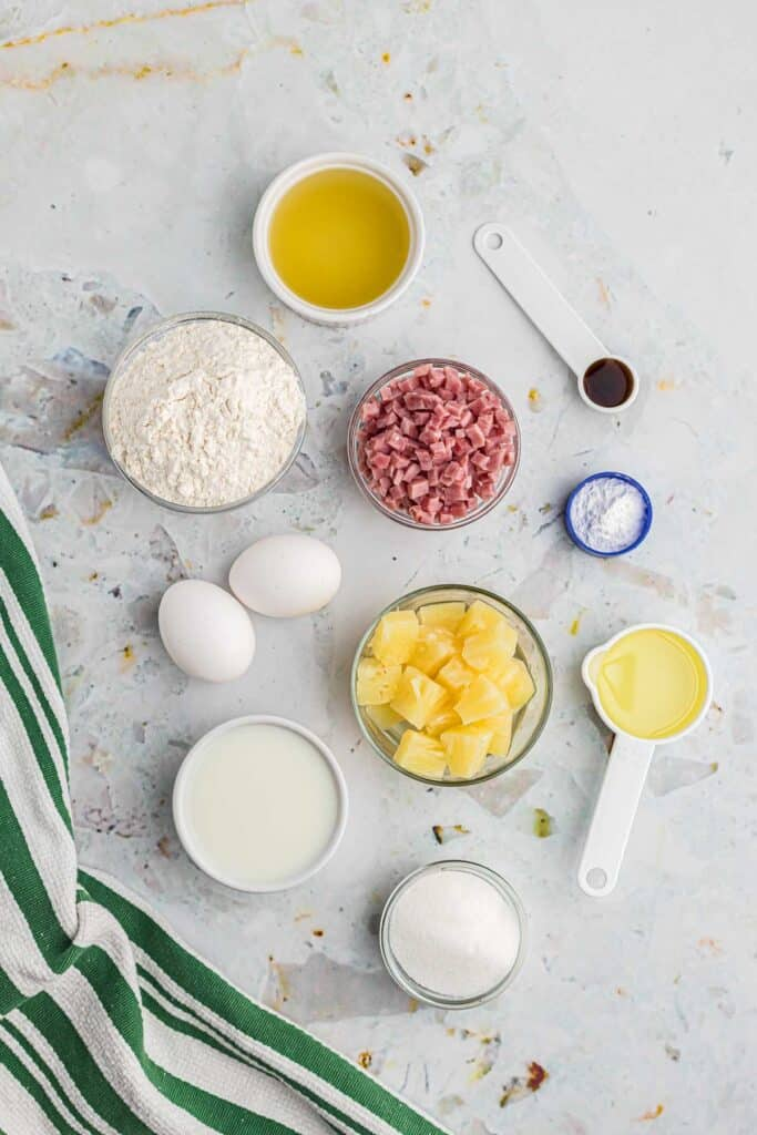 Overhead view of ingredients needed to make sheet pan pancakes with ham and pineapple.