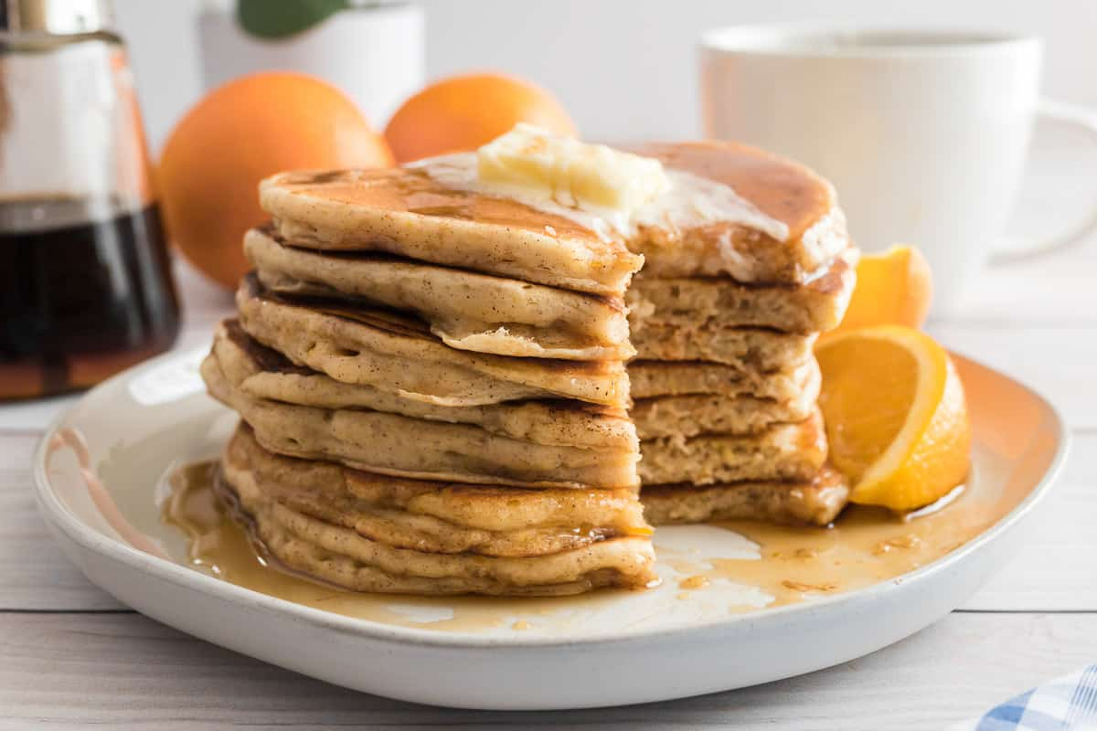 Stack of pancakes with a wedge cut out.