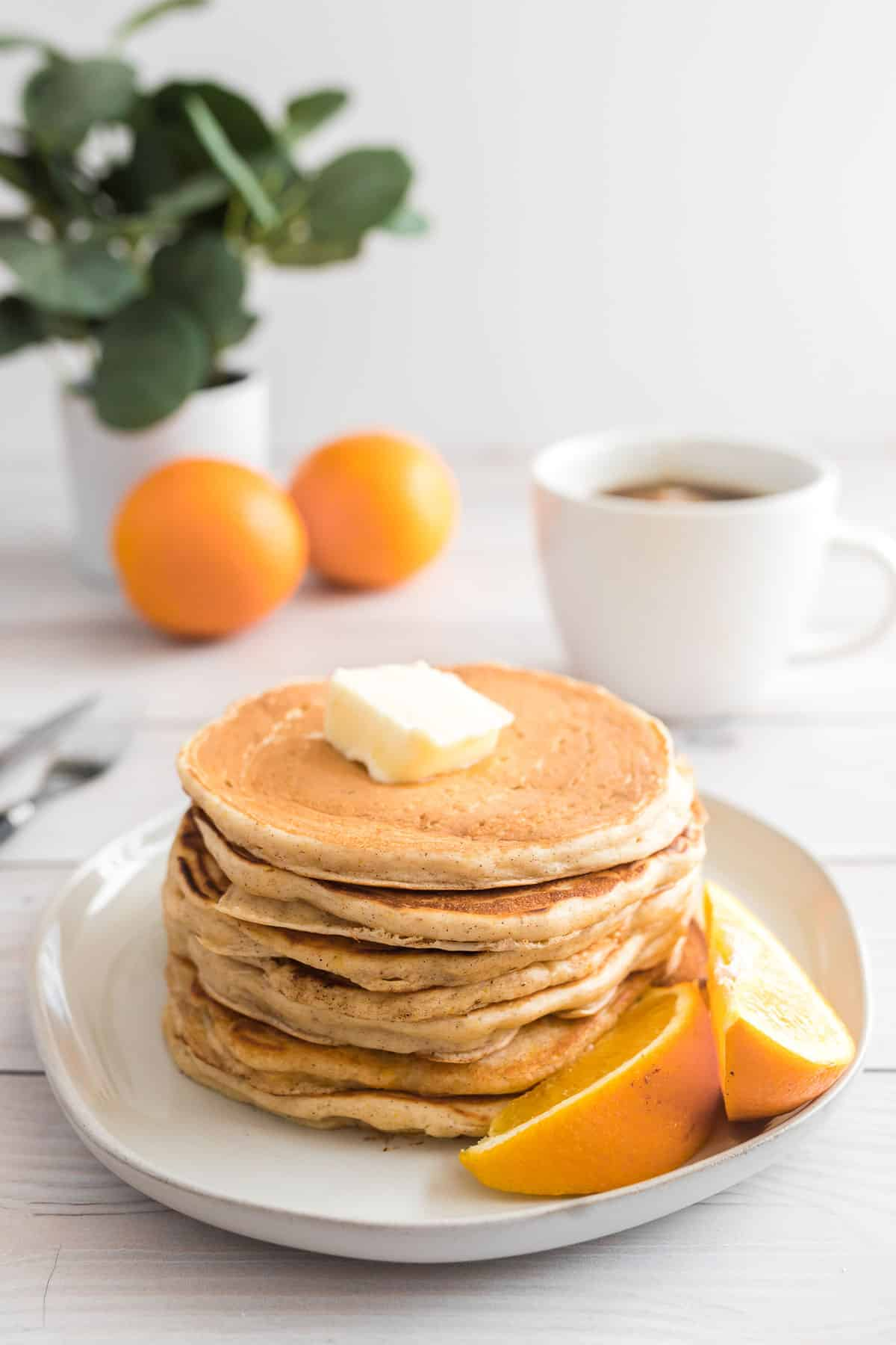Stack of orange buttermilk pancakes.