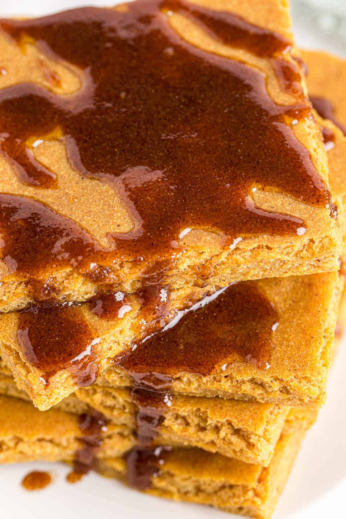 Close up of pancakes with cinnamon butter sauce.