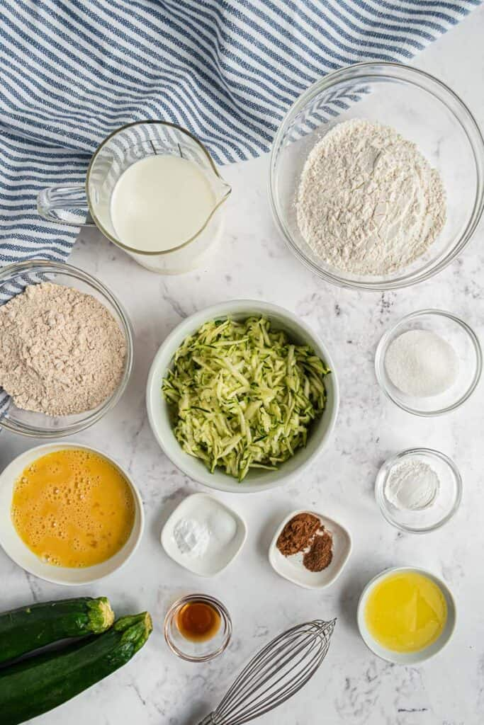 Overhead view of ingredients needed for zucchini bread pancakes.