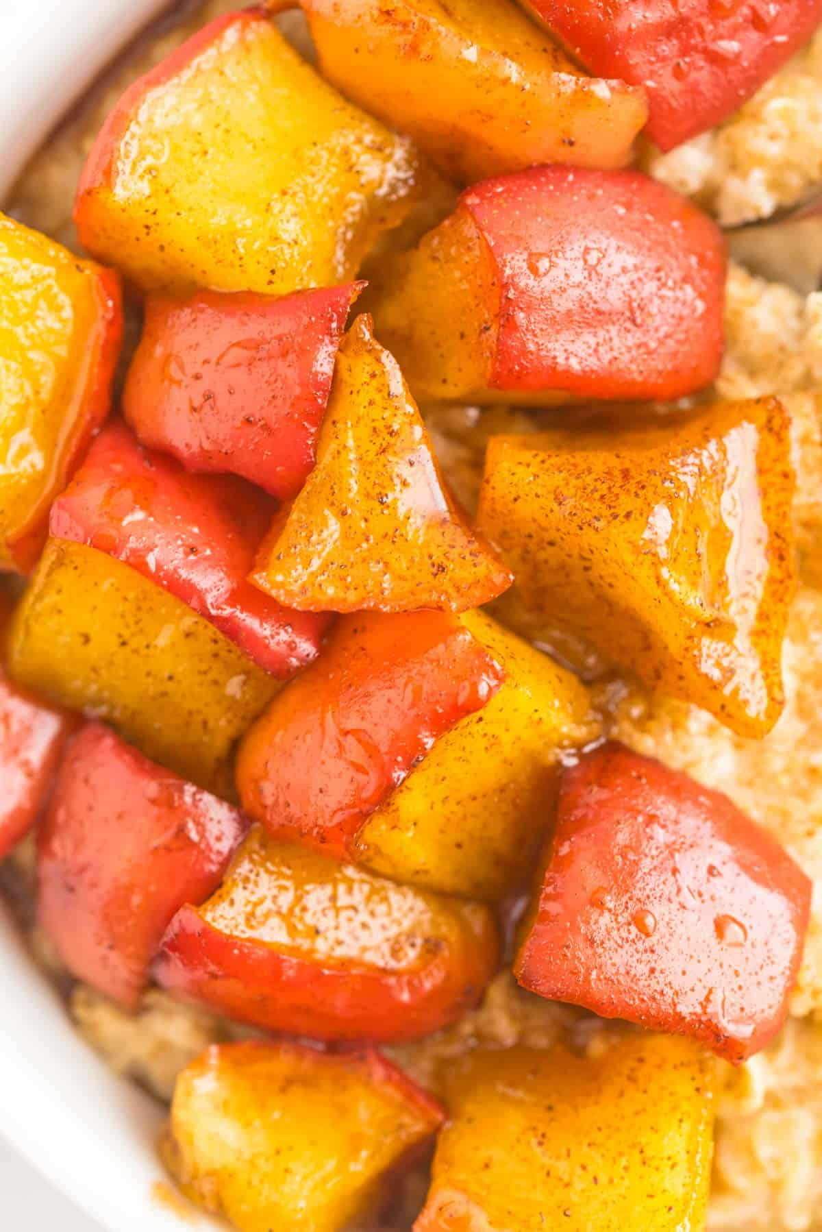 Close up of cooked diced apples in a cinnamon syrup.