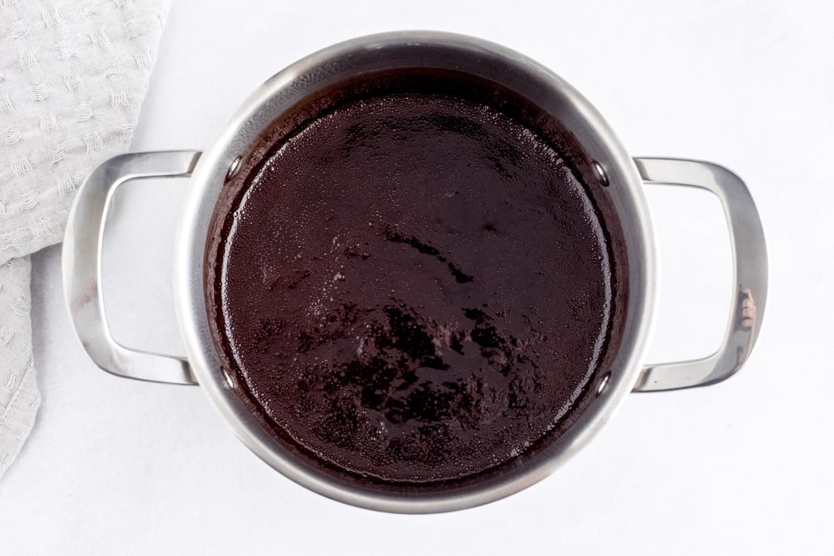 In process picture of chocolate sauce in a saucepan.