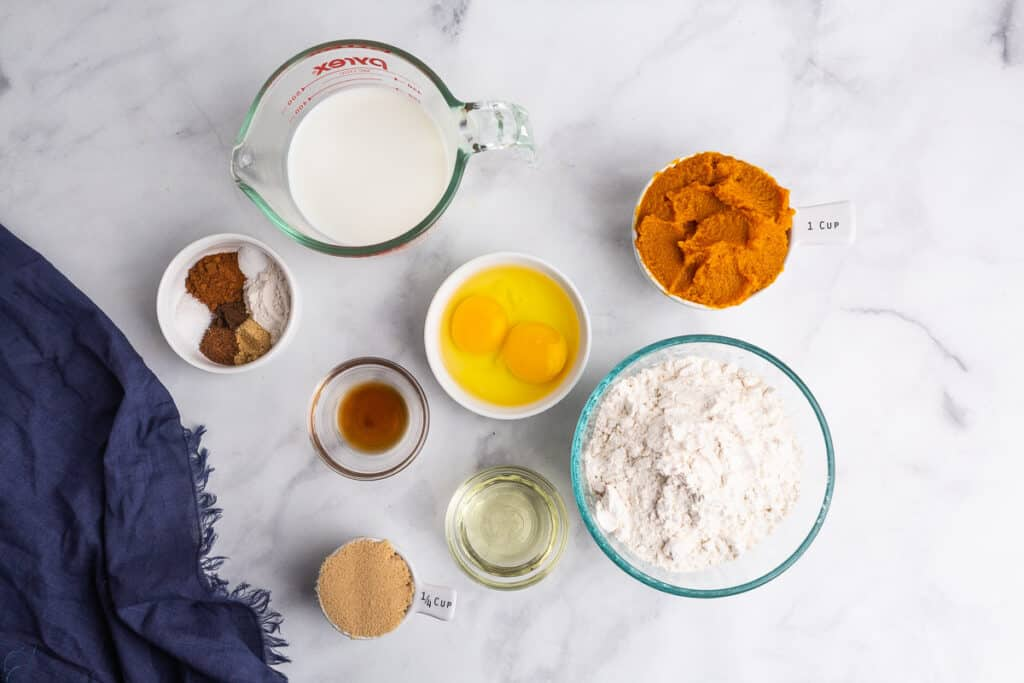 Ingredients needed to make pancakes with pumpkin puree.