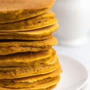 Stack of pancakes with no toppings.