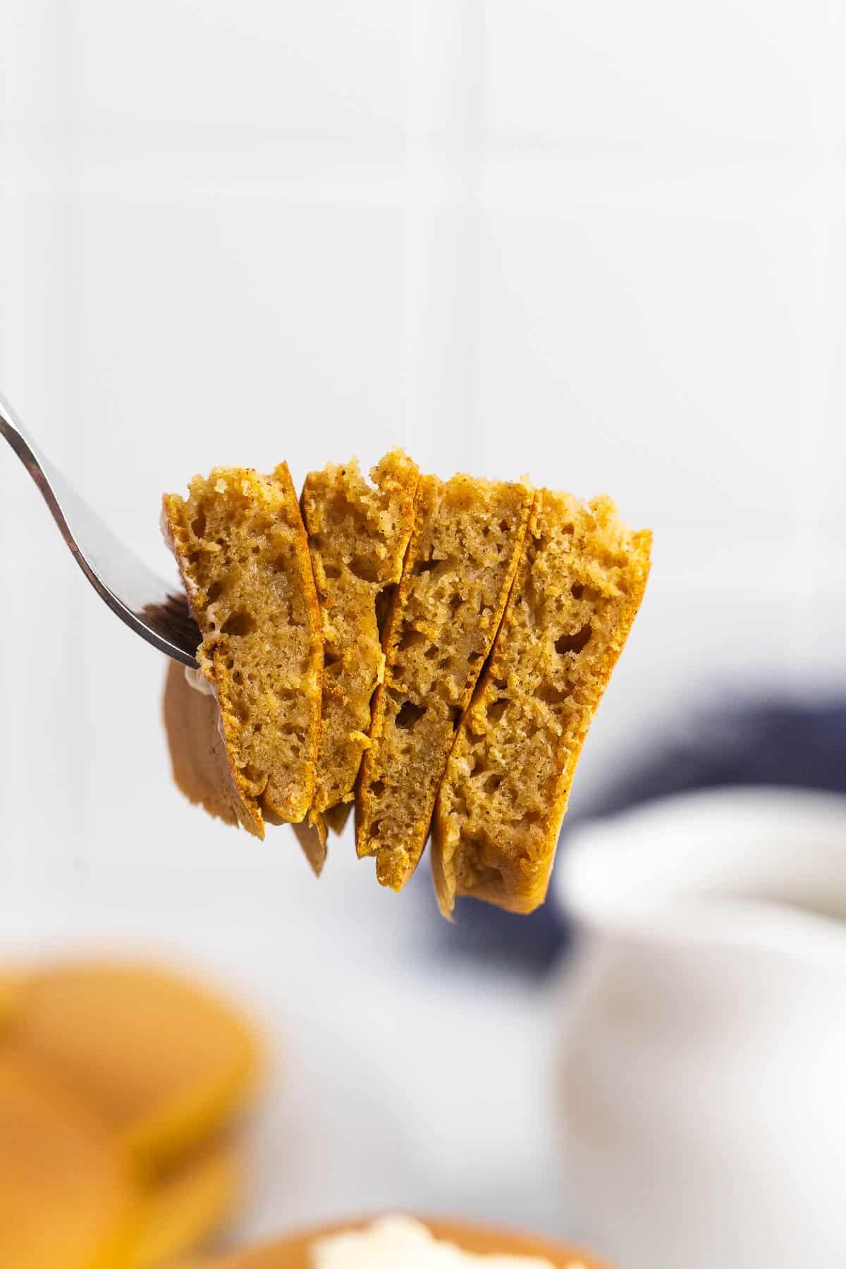 Pumpkin pancakes on a fork.