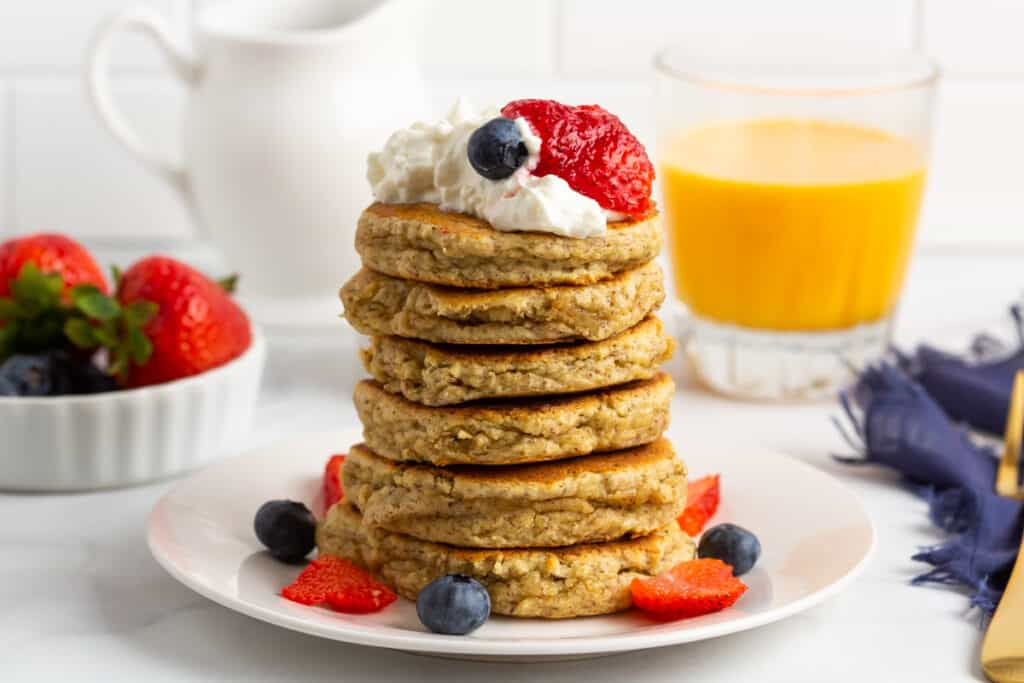 Tall stack of pancakes with toppings