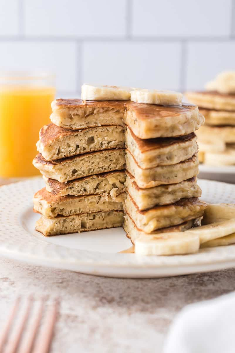 Stack of pancakes with wedge cut out to show texture.