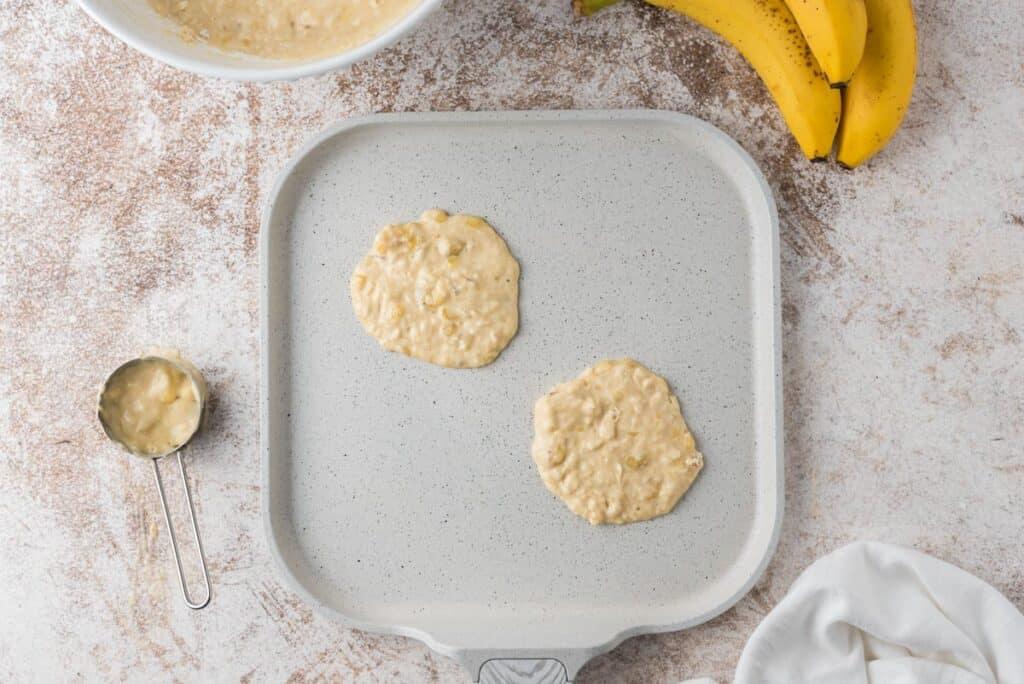 Pancake batter on a griddle.
