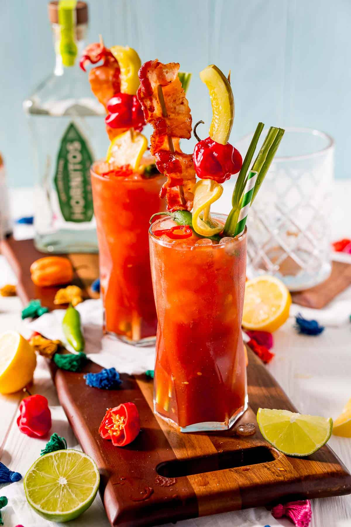 Tomato juice based cocktails on a wooden board.