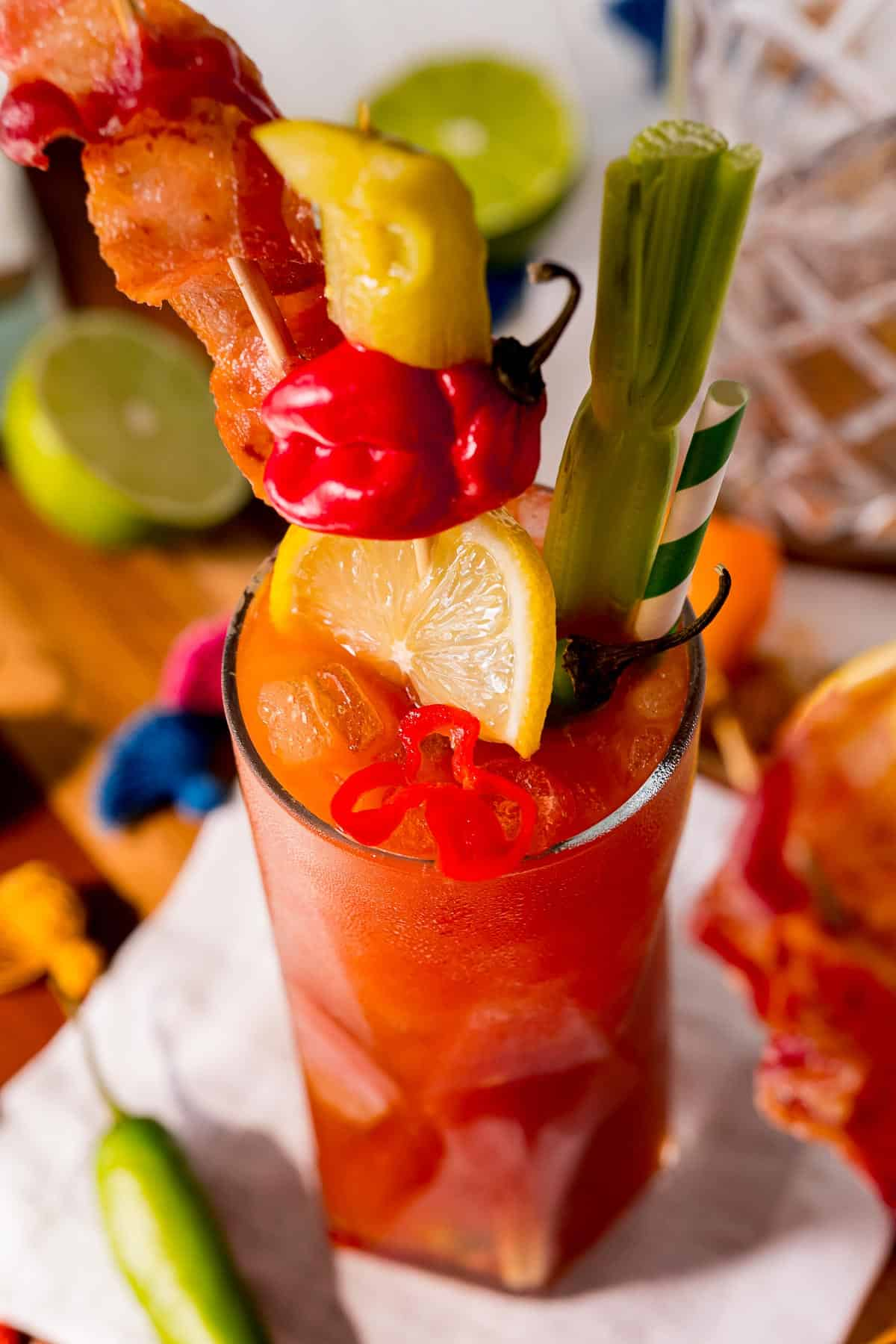 Close up overhead view of a heavily garnished bloody mary style cocktail.