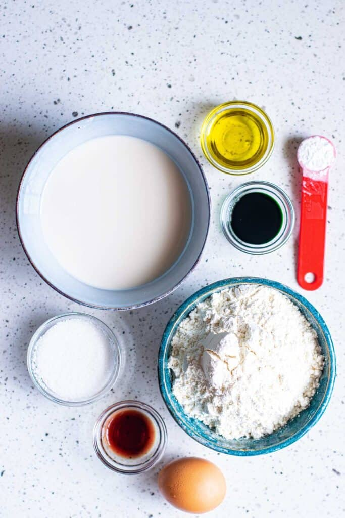 Ingredients needed to make Christmas pancakes, all in separate bowls.