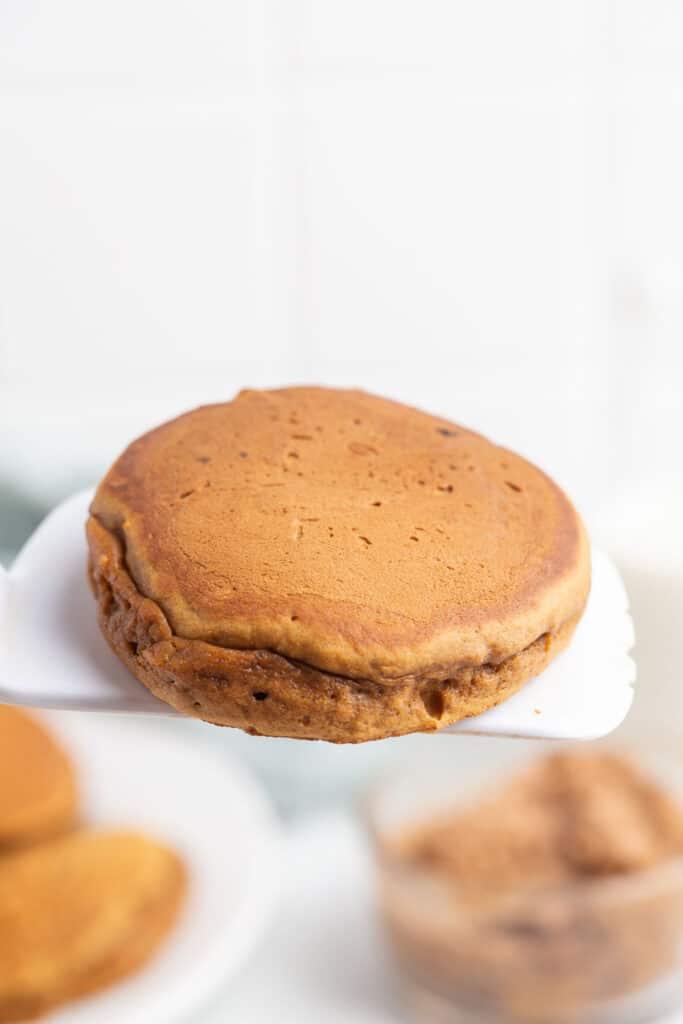 A gingerbread pancake on a white spatula.
