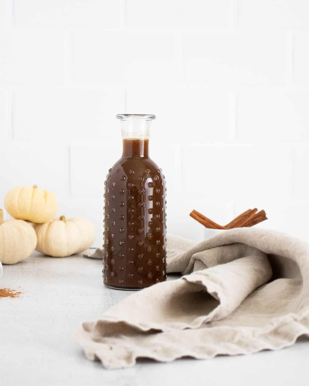 Pumpkin brown sugar syrup in a glass bottle.
