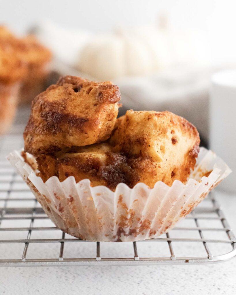 Pumpkin spiced monkey bread in a muffin wrapper.