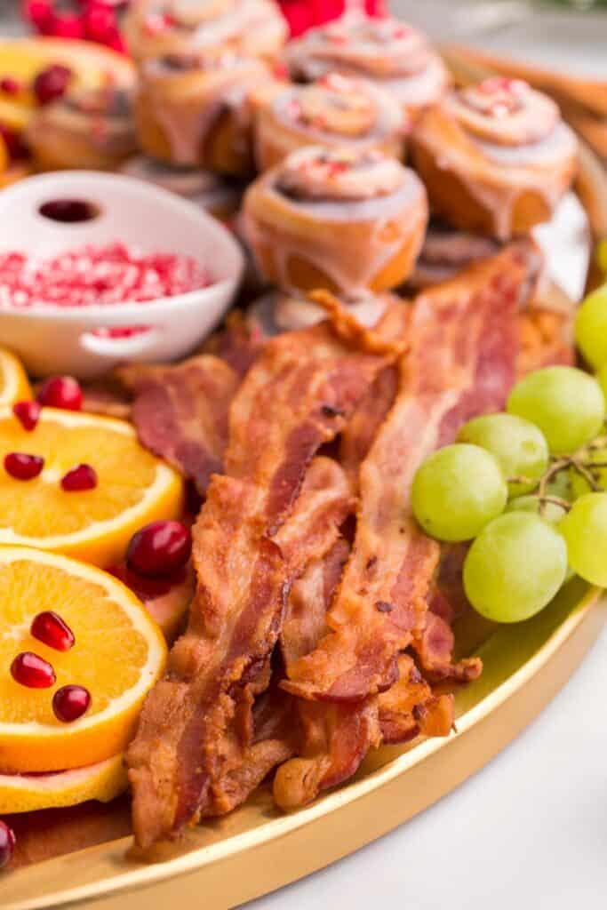 Bacon on a brunch charcuterie board.
