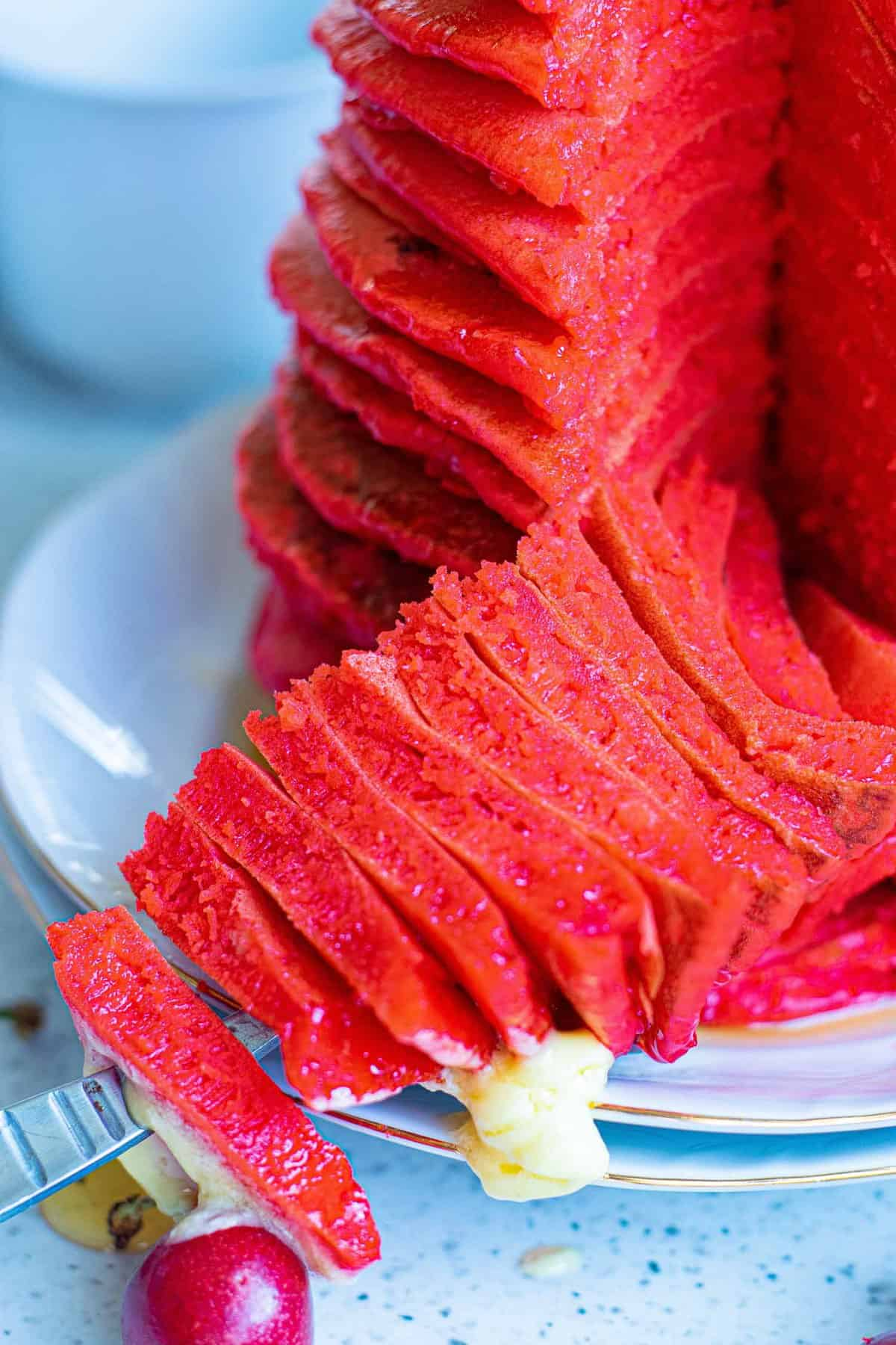Close up of fluffy red pancakes.