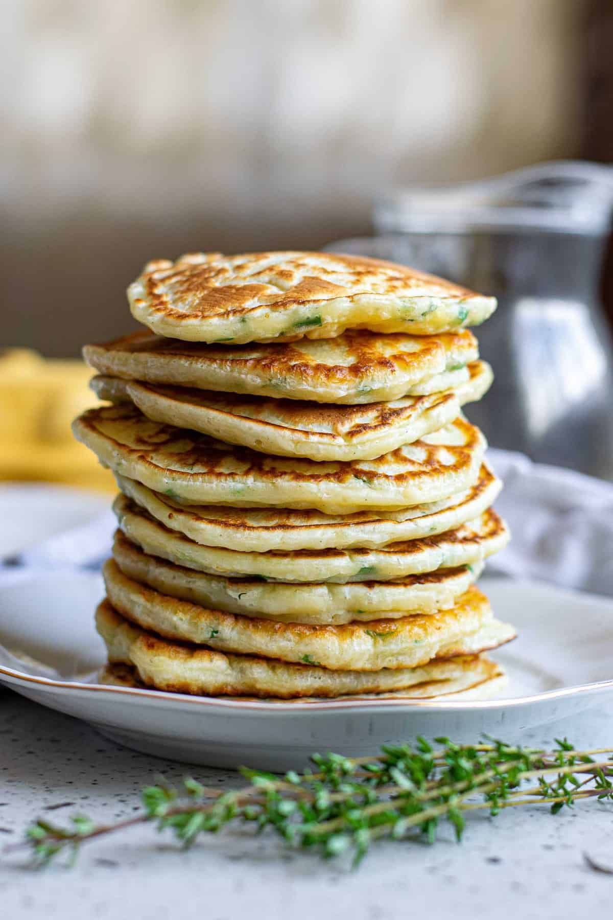 Savory pancakes stacked up with no toppings.