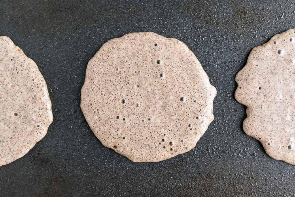Bubbles forming on pancakes.