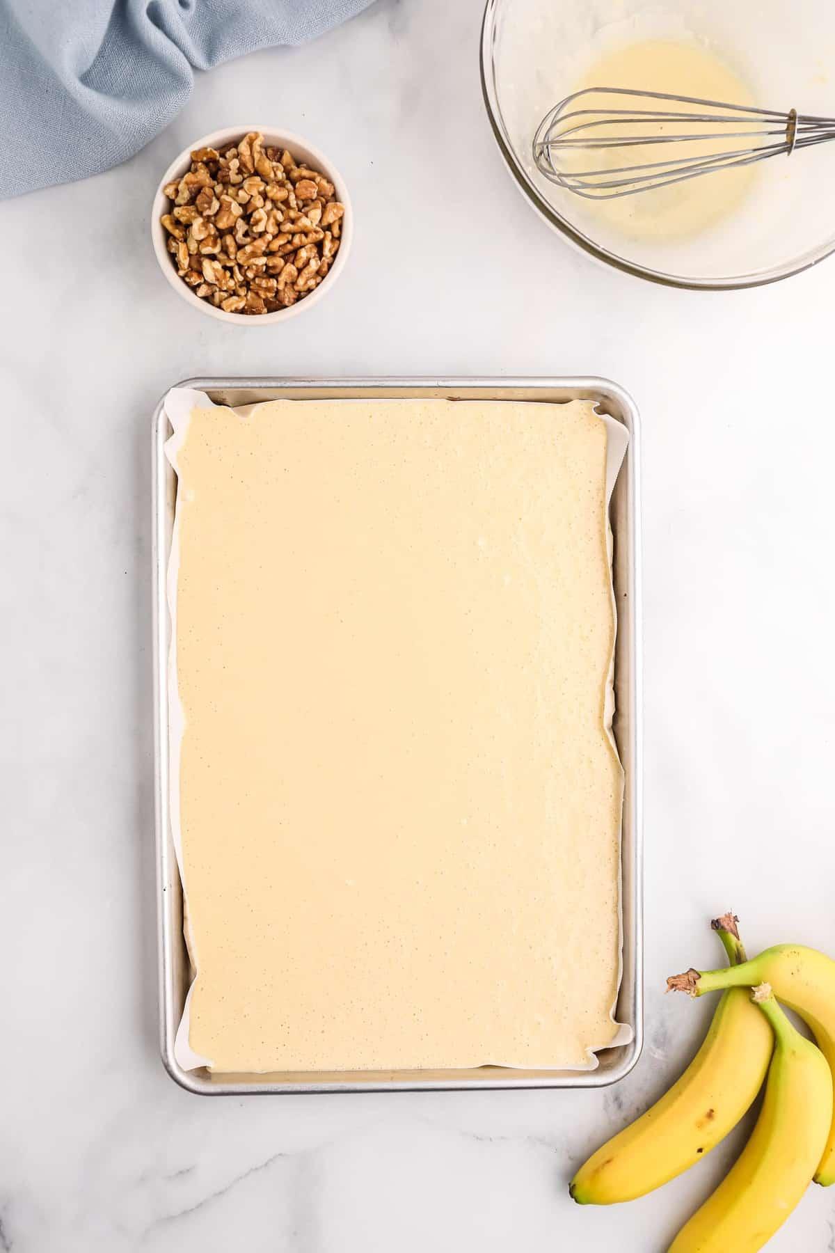 Pancake batter in a sheet pan.