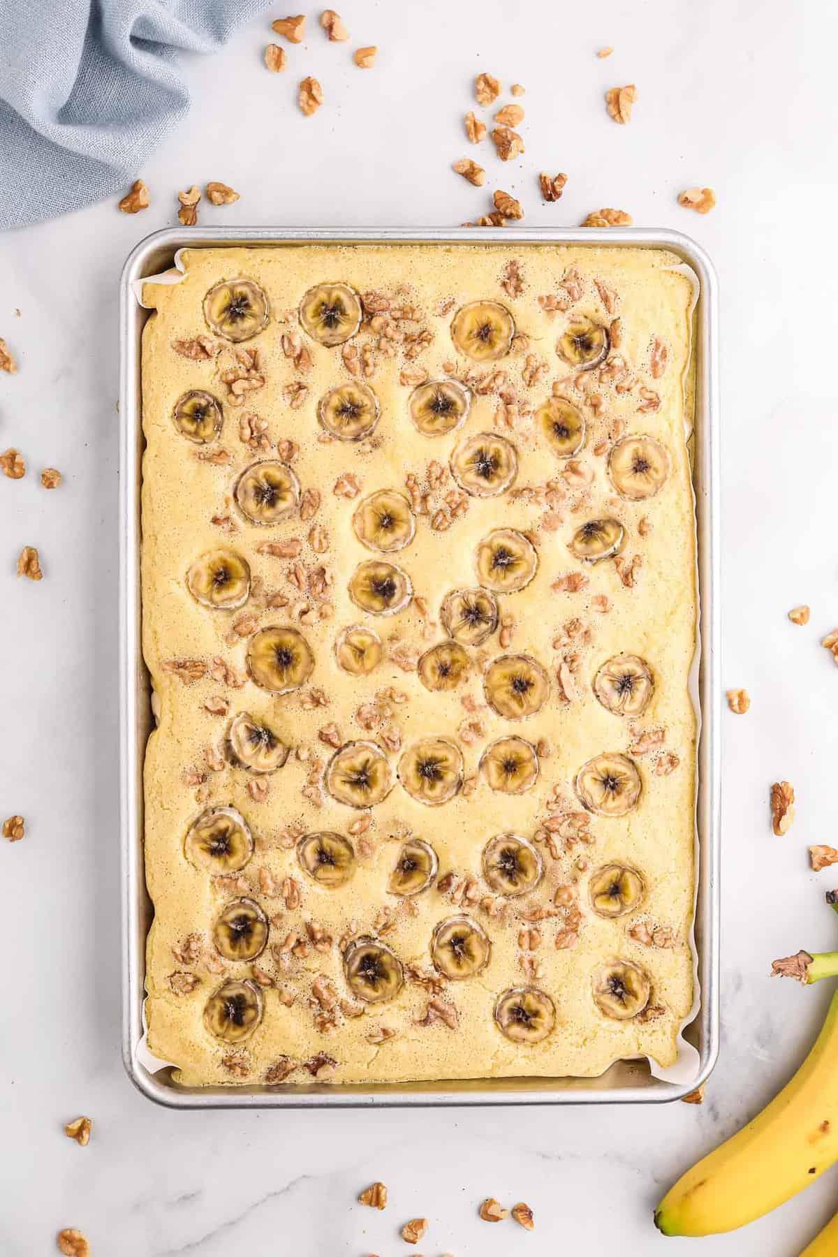 Overhead view of baked banana nut sheet pan pancake.