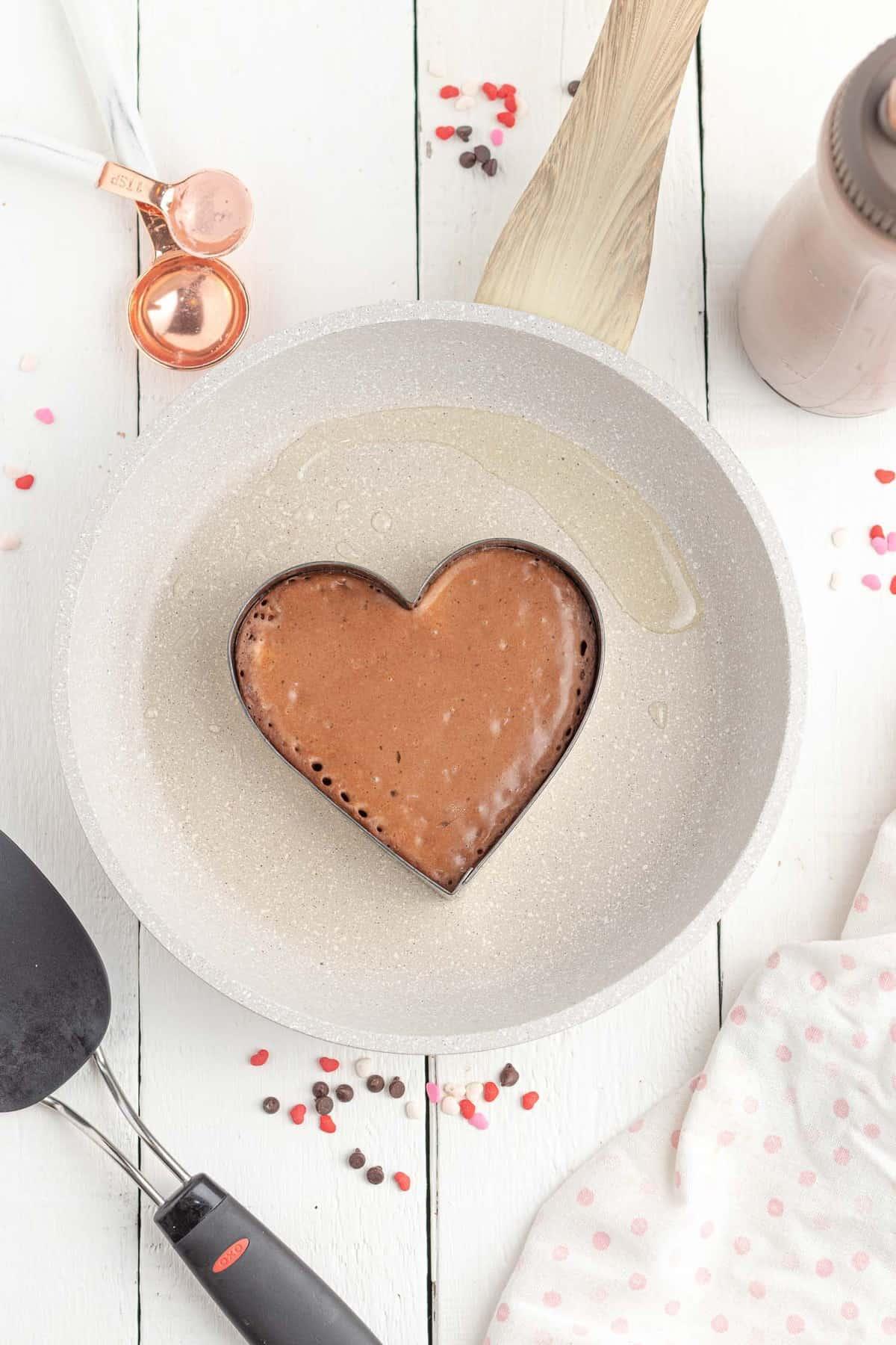 Pancake batter in a heart cookie cutter