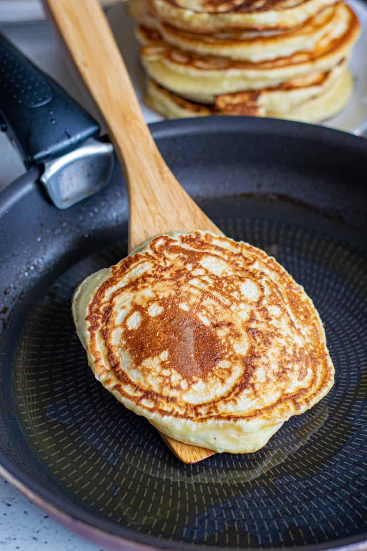 Pancake on a wooden spatula.