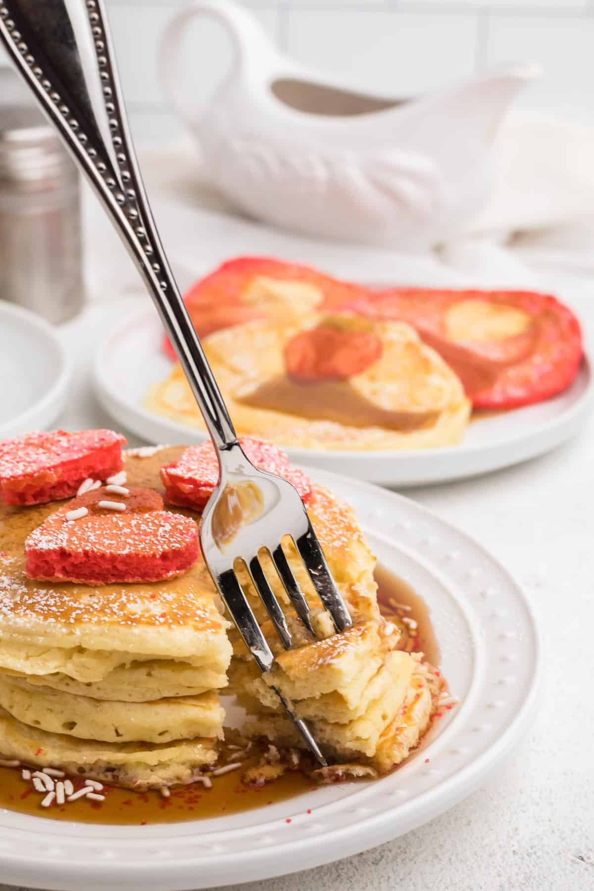 Pancakes being picked up with a fork.