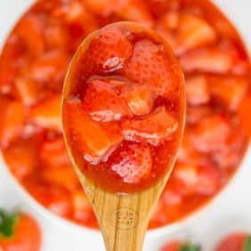 Close of strawberry sauce on a spoon.