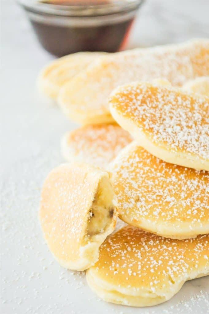 Pile of banana stuffed pancakes.
