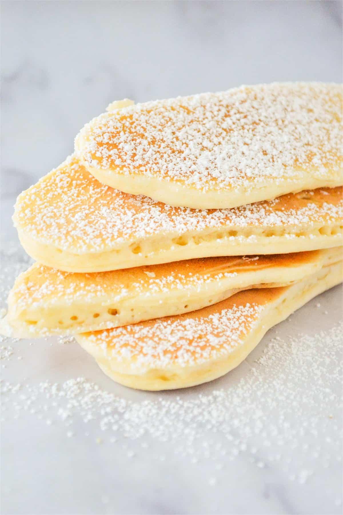 Stacked up long skinny pancakes.
