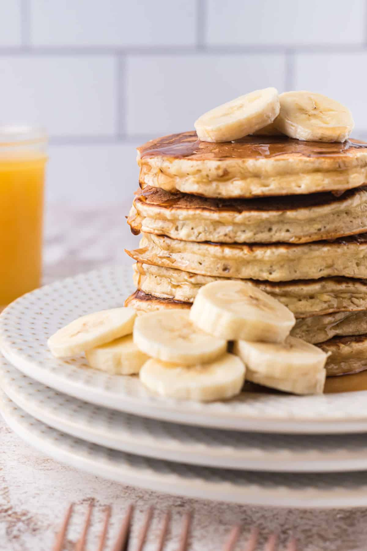 Stack of pancakes with bananas.