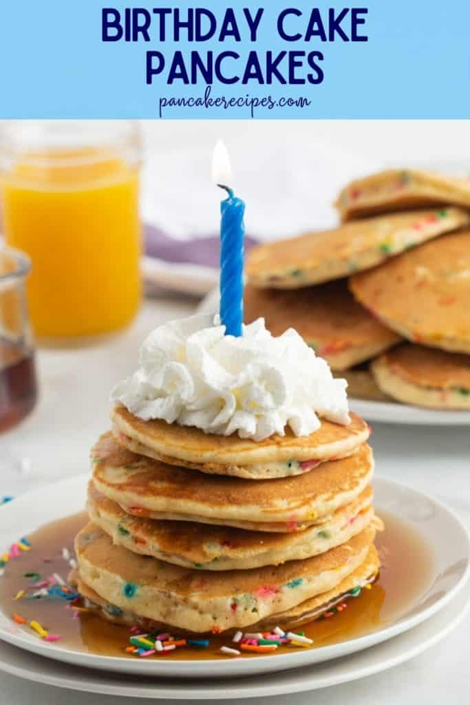 """Pancake stack with whipped cream and a candle, text overlay reads """"birthday cake pancakes, rachelcooks.com"""""""