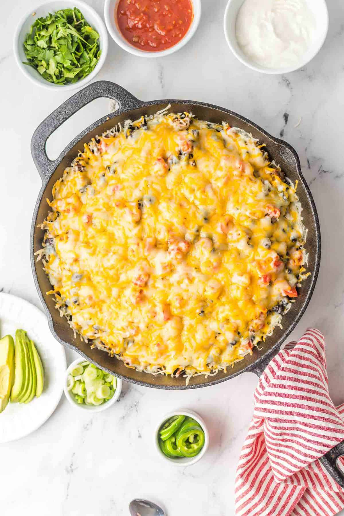 Cheese melted on a pan of nachos.