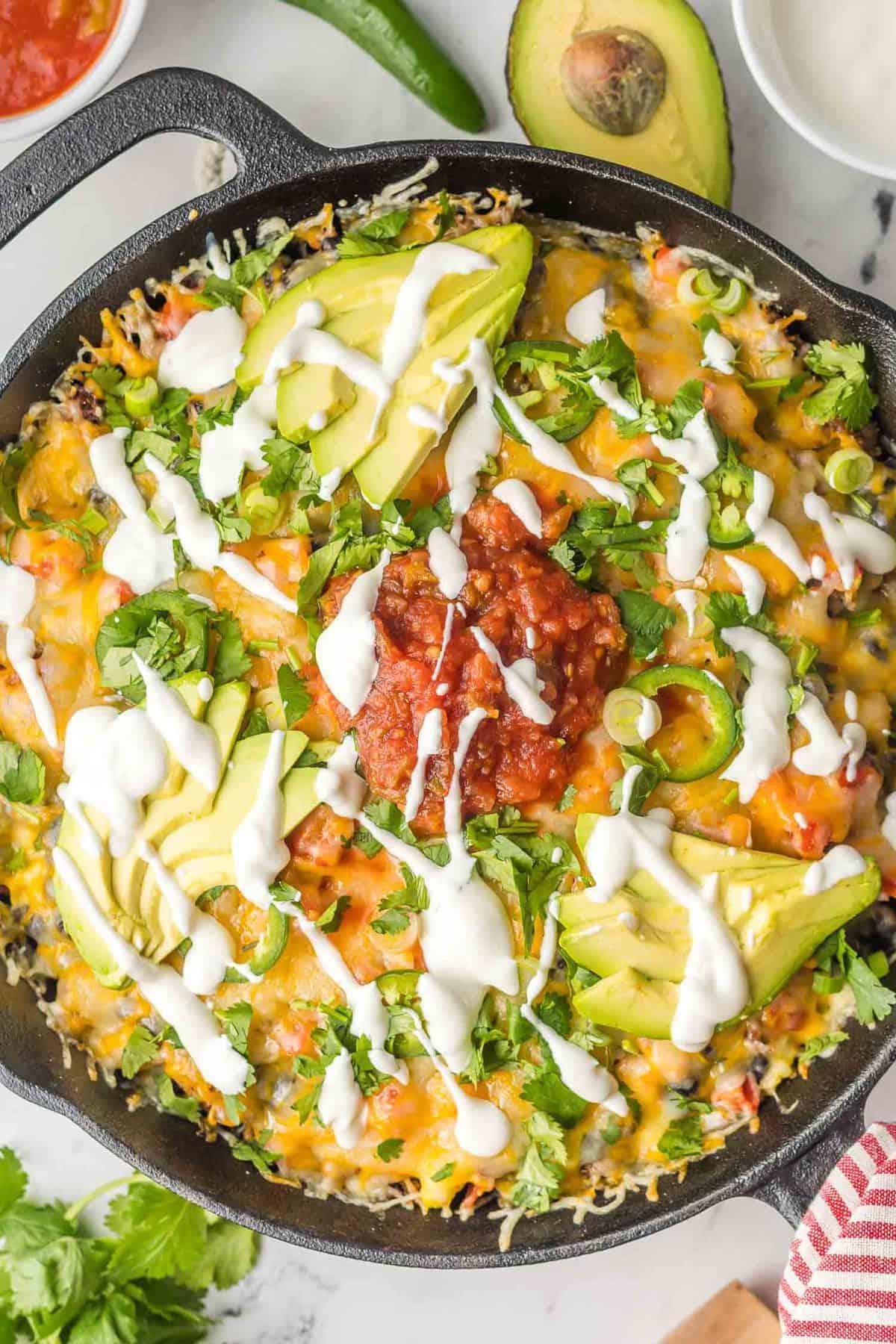 Close up view of garnished nachos.