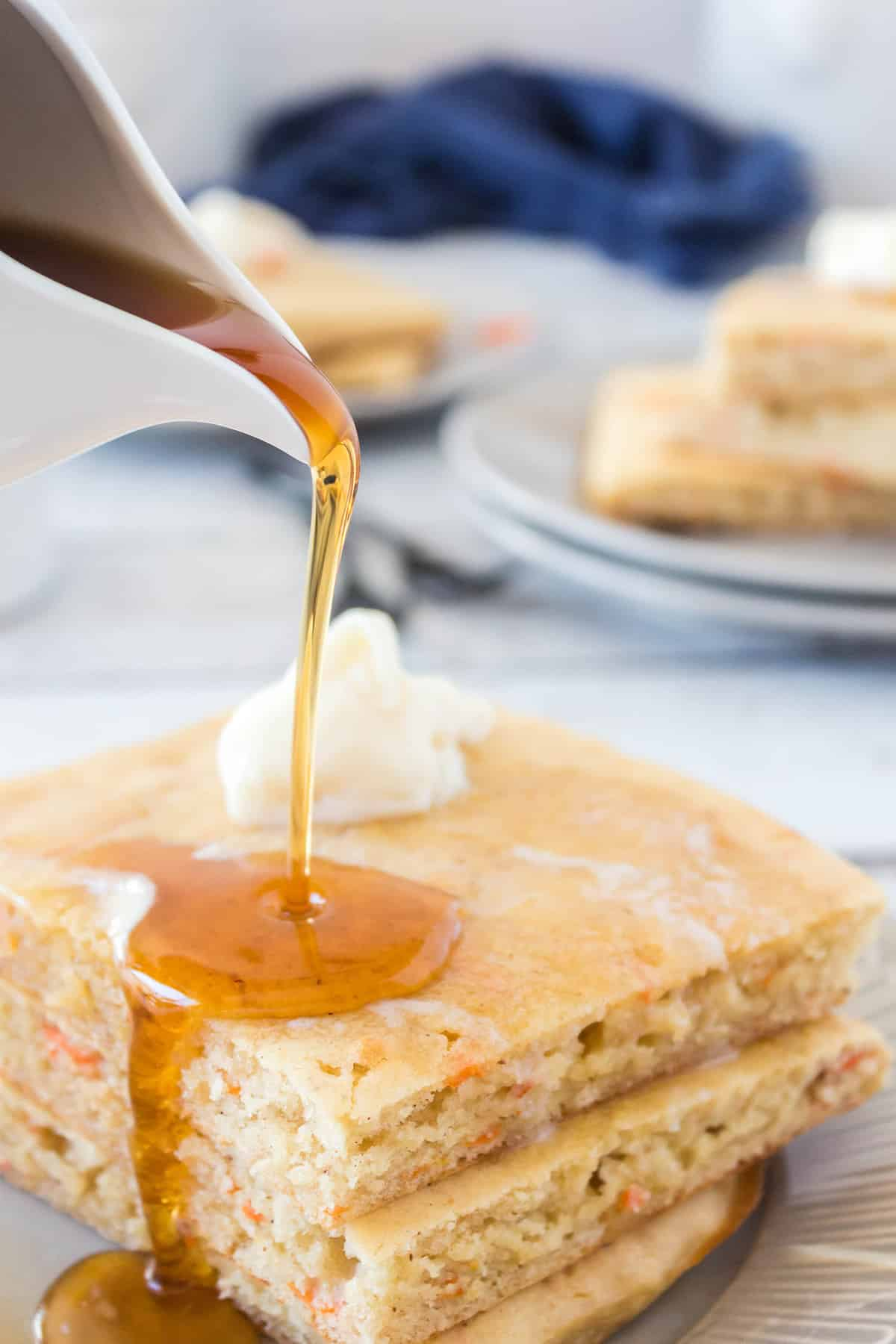 syrup being poured on carrot pancakes