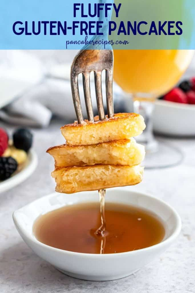 """Pancakes being dipped in syrup, text overly reads """"fluffy gluten-free pancakes, pancakerecipes.com"""""""